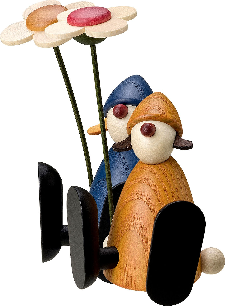 Björn Köhler Gratulantin Lotta mit Blume, sitzend