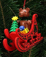 tree ornament teddy on sleigh