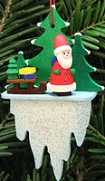 tree ornament Santa Claus with sledge on icicle
