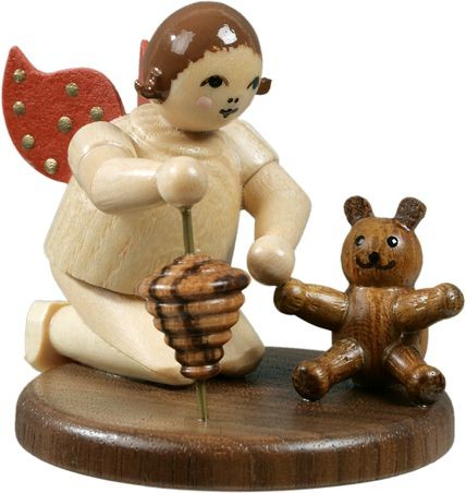 Angel kneeing with teddy and spinning top / natural without-crown