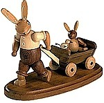 rabbit das with son on a handcart